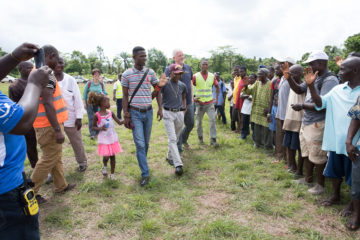 Sampson with his cousin (at left), Samaritan's Purse Liberia Country director Kendell Kauffeldt (right), and Children's Heart Project director Cindy Bonsall (rear left).