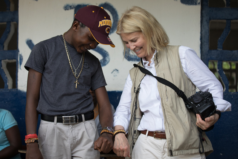 Greta and Sampson show off matching bracelets in his home village.