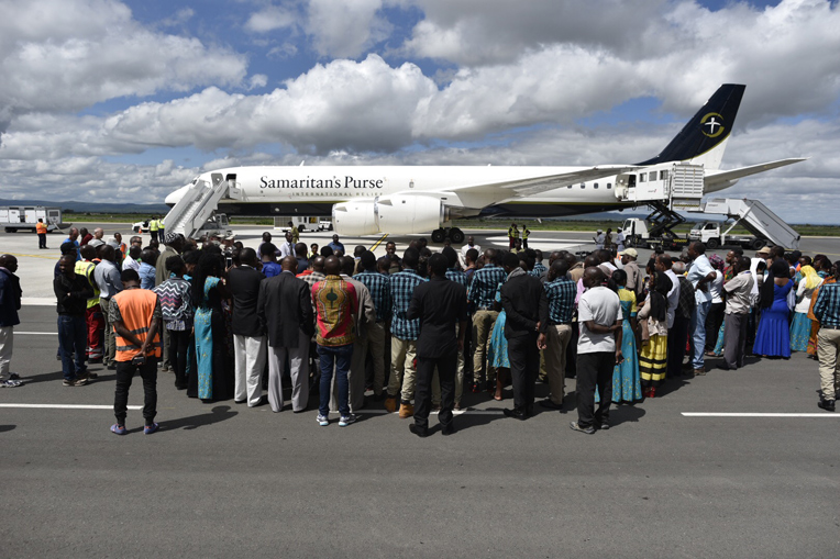 Well wishers came out to see the three children before they left Tanzania for the U.S. aboard the Samaritan's Purse DC-8.