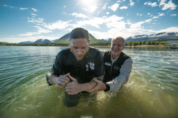 Navy Petty Officer First Class Eric Buelow was baptized on Friday June 2 in Lake Clark. Saved earlier in the week, his new relationship with Christ is the key to transforming his marriage to Rhonda. [Chaplain Dan Stephens is at right.]