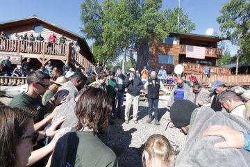 Dr. James Dobson prays for military couples baptized at Samaritan Lodge Alaska.