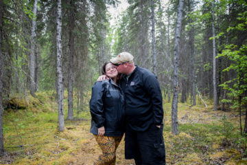 Cody and Alexis (kissing) share a fun moment in the Alaska woods.