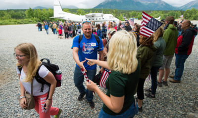 Marine Sergeant Daniel Erlandson and his wife Theresa (front left) were warmly greeted on July 2.