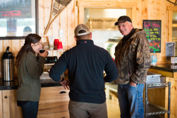 Franklin Graham speaks with Fiona and Marine Sergeant Hubert Gonzales at Samaritan Lodge Alaska.