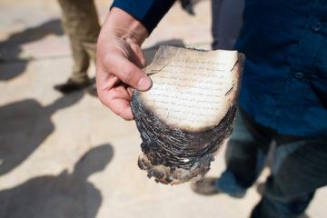 A burned portion of Scripture.