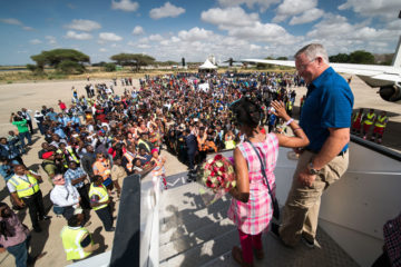 Doreen, accompanied by Kevin Negaard, steps down from our DC-8 plane to a welcoming crowd in Tanzania on August 18.