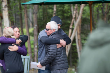 Walter and Elana hug our staff after receiving a Billy Graham Study Bible in Alaska.