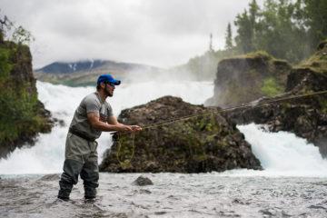 Luis enjoys fly fishing in Lake Clark.