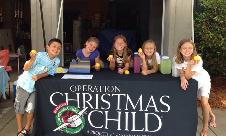 Anna (right) and Tracy (second from right), then 11 and 7 respectively, host the Operation LemonAid stand in the Musselwhite driveway together with their friends.