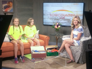 : Tracy (left) and Anna share about Operation LemonAid on their local television station.
