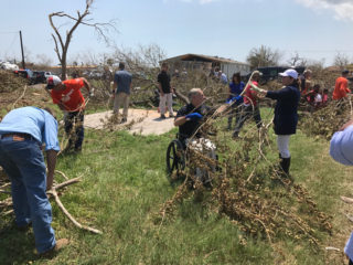 Texas Governor Greg Abbott assists in cleanup at one of our Samaritan's Purse work sites.