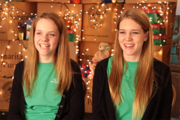 "Sisters Ashlee (left) and Ally Davies serve together in Student Relations for Operation Christmas Child. Ally said that shoebox recipients ""get to hear the message of Christ and the multiplication process happens, so maybe their whole village hears the Gospel."""