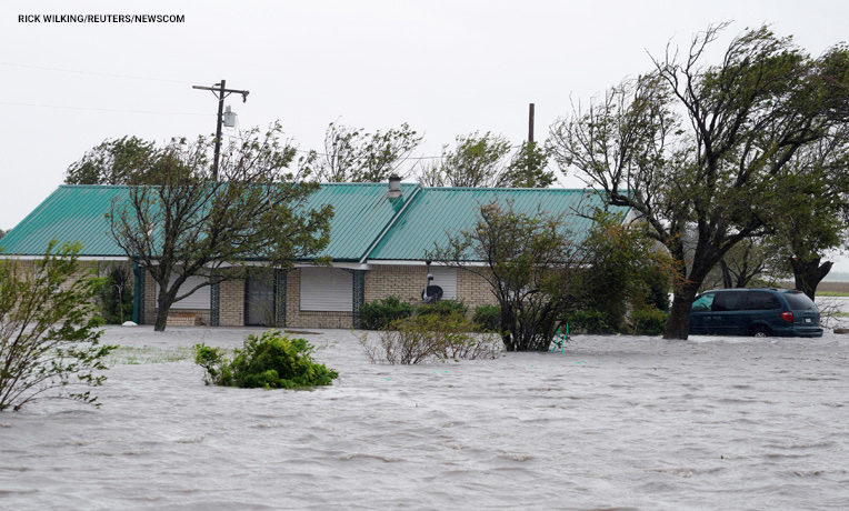 A ranch house is surrounded by floodwaters from Hurricane Harvey near Port Lavaca, Texas.