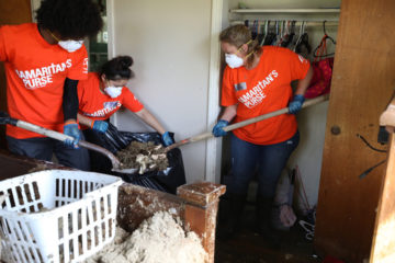 Samaritan's Purse volunteers clean up in a home in Victoria, Texas.