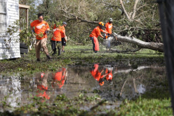 Volunteers begin clean up in Victoria, Texas, following Harvey's lashing.