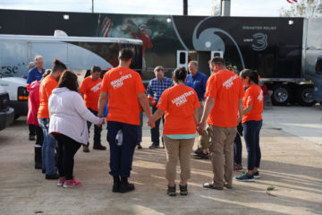 Samaritan's Purse volunteer teams start the day in prayer in Victoria, Texas.
