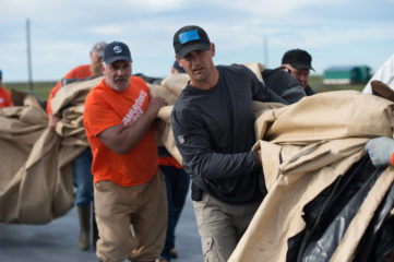 Corey Lynch, director of Alaska projects, joins the rebuilding effort.