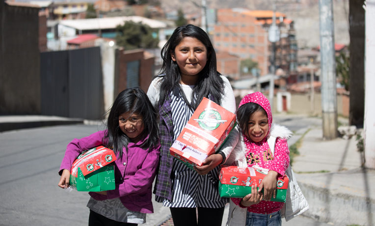 Rebeca, 13, invited Andrea, 8, and Ada, 9, to her church's Operation Christmas Child outreach event.
