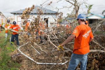 Volunteers in Rockport clear debris from the Reeves' yard.