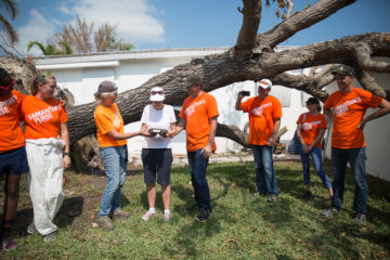 Our teams present a Bible to a homeowner in the Keys.