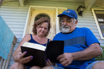 John Bassaillon and his wife Catherine read their new Bible after receiving Jesus Christ as their Savior.