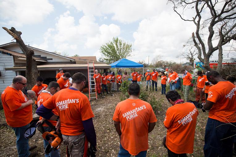 Samaritan's Purse volunteers pray at José's father's home.