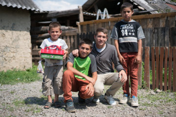 Ruslan (second from right) and his brothers all support their grandfather in his preaching.