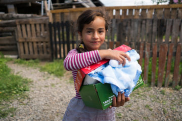 Operation Christmas Child shoebox gifts bring good news and great joy to children like this one in Ukrainian Roma villages.