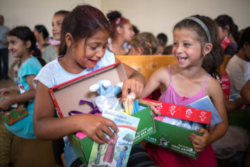 Girls from Serendne rejoice as they open their shoebox gifts.
