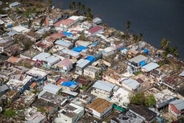 Hurricane Maria ripped off many roofs in this neighborhood near the shore of Laguna Los Corozos bay. Our blue shelter tarps are helping prevent further damage to homes.