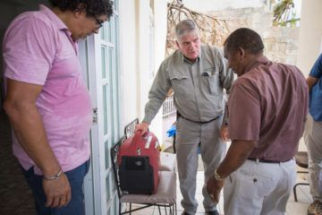Franklin Graham provided Norberto Colon, a local pastor, with a new generator and took the time to get it up and running.