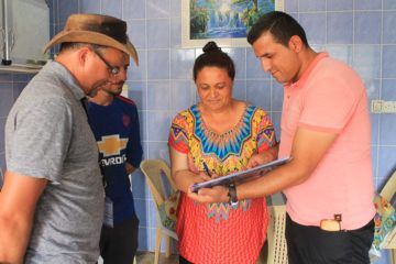 A Christian homeowner in Qaraqosh signs off on their completed repairs from Samaritan's Purse.