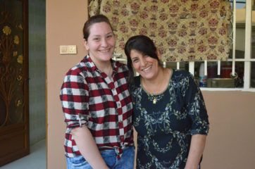 Miriam and Athra thank God for their restored home in Qaraqosh.