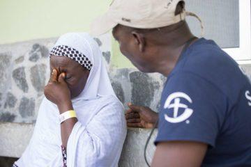 Thomas Benson comforts Fatima as she relives the horror of the Ebola crisis.