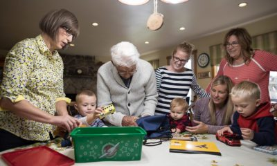Four generations gather to pack Ira's 100th shoebox gift.