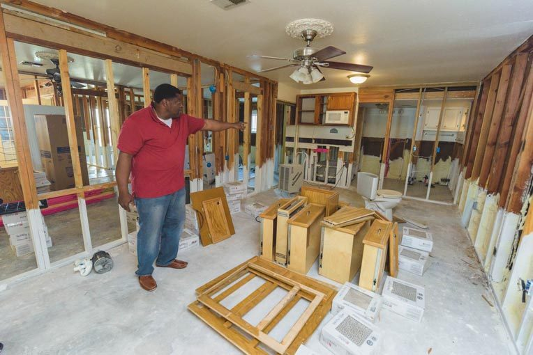 George Dorsey points out the work Samaritan's Purse has done to prevent mold in his house.