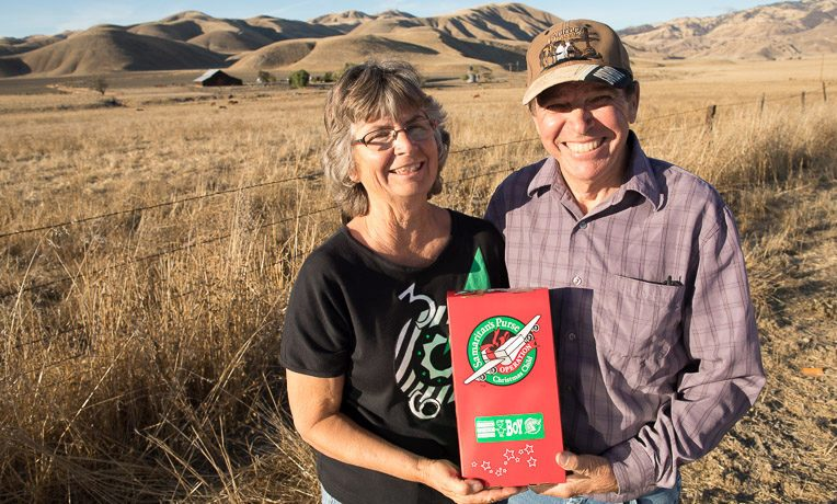 Pastor Bill and Robin Rist pause to show their support of Operation Christmas Child in front of their rural California home.