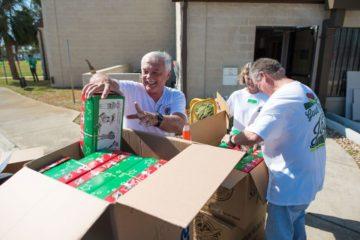 First Baptist Rockport volunteers pack shoeboxes.