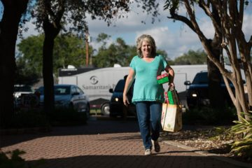 Sharon Woody packs shoebox gifts so that the Gospel can be spread to children across the world.