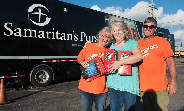 Sharon Woody (middle) has packed Operation Christmas Child shoebox gifts for many years. After her home sustained major damage during Hurricane Harvey, Samaritan's Purse volunteers worked hard on her home. Sharon attends First Baptist Church of Portland, where our disaster relief unit has been set up since the end of August. The church is also a shoebox drop-off location.