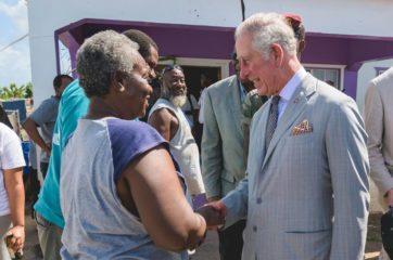 Prince Charles greets Netta Williams on Barbuda.