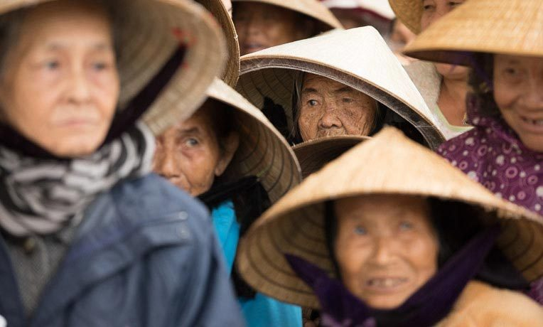 Survivors of Typhoon Hamrey wait in line for supplies from our DART teams.