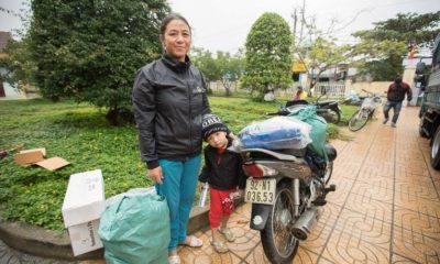 """We supplied Ngoan Thi Phung and her family with heavy duty shelter plastic, kitchen kits, hygeine items, and other essentials. """"When I heard the wind, I knew a big storm had come so I just ran out of the house,"""" she said."""