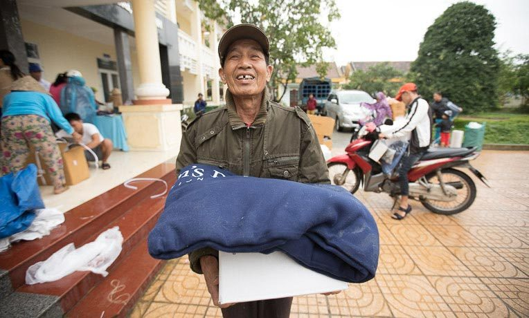 """Ngoc Nhu Phan's metal roof was blown off in the storm that destroyed the homes of nine neighbors. """"I'm so thank for the foreigners who've come to help us,"""" he said."""