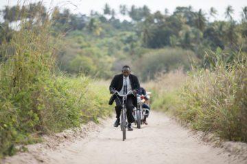 Pastor Marco Kayumbo rides his bike two hours to lead his church plant Maranatha Church Kitomondo.
