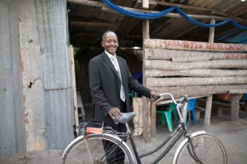 "Pastor Marco Kayumbo rides his bike twice weekly to preach at his church plant Maranatha Church Kitomondo. ""I don't need money. I don't need a car. Just give me shoeboxes."""
