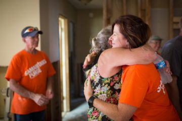 Site team leader Tracey McGillis hugs Dawn's mother. Tracey came from Canada to help Florida homeowners.