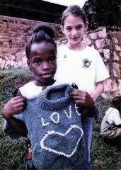A young girl in Africa received this Lamb's Wool sweater in her Operation Christmas Child shoebox.