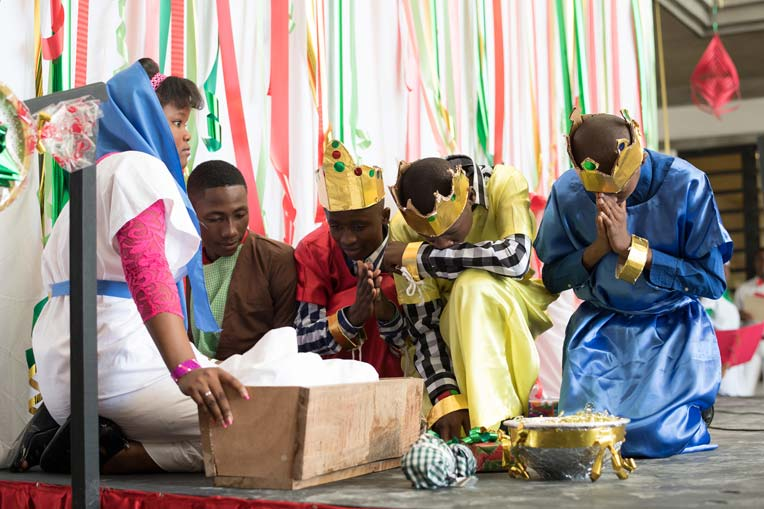 The three kings worship the Christ in the Christmas pageant.