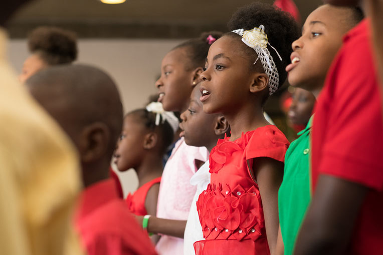 Children singing at Greta Home